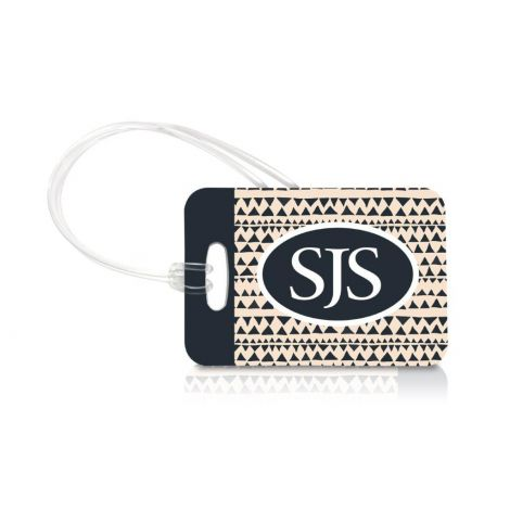 Identify your luggage in style with a personalized monogram luggage tag. Behind your bold, monogrammed initials a triangle, tribal pattern gives this tag a modern geometric look.